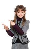 Het jonge meisje toont haar vinger aan de kant Stock Fotografie
