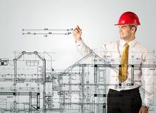 Een jonge architect die een huisplan trekken Stock Afbeeldingen
