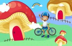 Een jonge fietser dichtbij het reuzepaddestoelhuis royalty-vrije illustratie