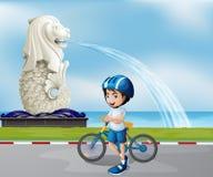 Een jonge fietser dichtbij het standbeeld van Merlion stock illustratie