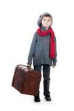 Een jonge jongen die houten boomstam houdt Stock Foto's
