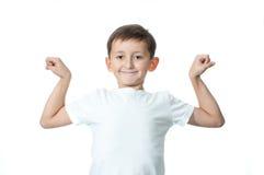 Een jonge jongen die over witte achtergrond wordt geïsoleerd. Royalty-vrije Stock Afbeeldingen