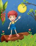 Een jonge jongen die zijn hand golven Stock Fotografie