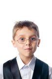 Een jonge jongen in glazen Stock Afbeeldingen