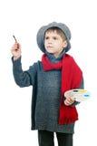 Een jonge jongen kleedde zich omhoog in een uitstekende schilder Stock Fotografie