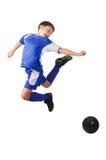 Een jonge jongensvoetbalster Stock Afbeeldingen