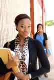 Een jonge leraar met een student op de achtergrond. Stock Afbeeldingen
