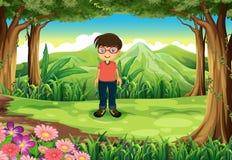 Een jonge nerd bij de wildernis Stock Foto
