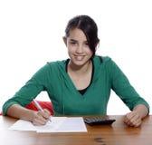 Een jonge vrouw met pen Stock Foto