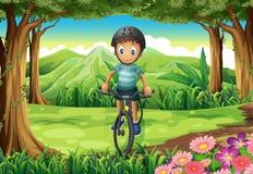 Een jongen die bij de wildernis biking royalty-vrije illustratie