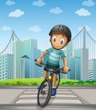 Een jongen die in de stad biking vector illustratie