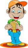 Een jongen die een sandwich eet Stock Foto's