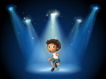 Een jongen die met schijnwerpers dansen Royalty-vrije Stock Afbeelding