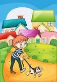 Een jongen die met zijn huisdier wandelen Stock Foto