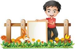 Een jongen en een konijntje stock illustratie