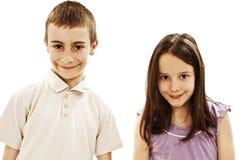Een jongen en een meisje lachen Stock Foto's