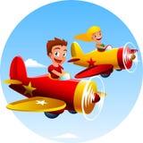 Een jongen en een meisjes vliegende vliegtuigen in de hemel Stock Fotografie