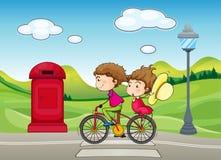 Een jongen en meisje het biking stock illustratie