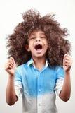 Een jongen met een funky kapsel Stock Foto's