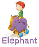 Een jongen op een stuk speelgoed olifant Stock Foto's