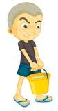 Een jongens dragende emmer Stock Foto's