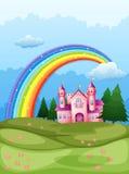 Een kasteel bij de heuveltop met een regenboog in de hemel Stock Afbeeldingen