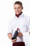 Een kelner met een fles wijn Royalty-vrije Stock Foto's