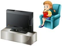 Een kind die op TV letten Stock Foto's