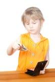 Een kind met een beurs en dollarrekeningen Royalty-vrije Stock Foto's