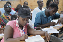 Een klaslokaal in Cite Soleil- Haïti. Stock Foto's