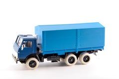 Een klein exemplaar blauwe vrachtwagens aan boord Stock Afbeelding