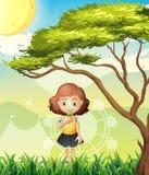Een klein meisje dichtbij de grote boom stock illustratie