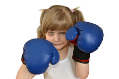 Een klein meisjeskind, jong geitje in bokshandschoenen Stock Fotografie