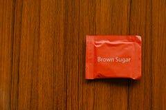 Een klein pak van een bruine suiker stock fotografie
