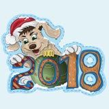 Een klein puppy houdt een Nieuwjaardatum 2018 Royalty-vrije Stock Foto's