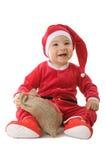 Een kleine jongen kleedde zich als Kerstman Royalty-vrije Stock Afbeeldingen