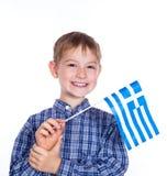 Een kleine jongen met Griekse vlag stock afbeeldingen