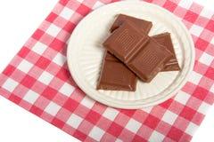 Een kleine plaat met zoete chocolade Stock Fotografie