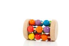 Een kleurrijke houten rammelaar Stock Foto's