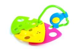 Een kleurrijke plastic tandjes krijgenring Stock Foto