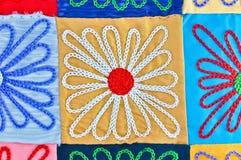 Een Kleurrijke Textiel in bloemvorm Stock Foto's