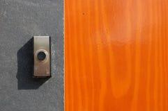 Een klok op een deur Royalty-vrije Stock Afbeeldingen