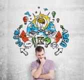 Een knappe jonge mens in vrijetijdskleding voorspelt de bouw van een businessplan voor bedrijfsontwikkeling Kleurrijke zaken Stock Foto's