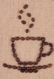 Een kop koffiebonen. Stock Afbeelding