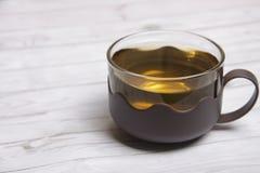 Een kop van groene thee stock foto's