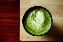 Een kop van groene theematcha latte Stock Foto
