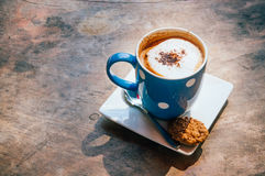 Een kop van koffie met koekjes Stock Afbeelding