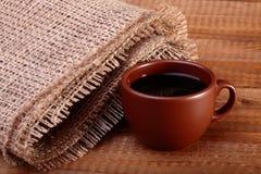 Een kop van koffie op lijst Stock Afbeeldingen