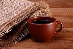 Een kop van koffie op lijst Royalty-vrije Stock Afbeeldingen