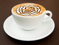 Een kop van latte-kunst hete koffie Stock Foto